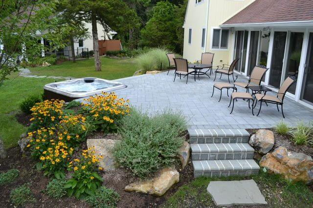 Deck with Brick Pavers and Hot Tub